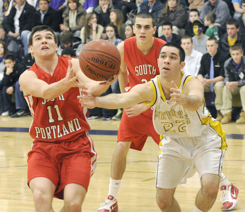 Steve Hodge of South Portland attempts to keep control of the ball Friday night as Joe Savino of Cheverus moves in during Cheverus 50-35 victory in a regular-season finale.