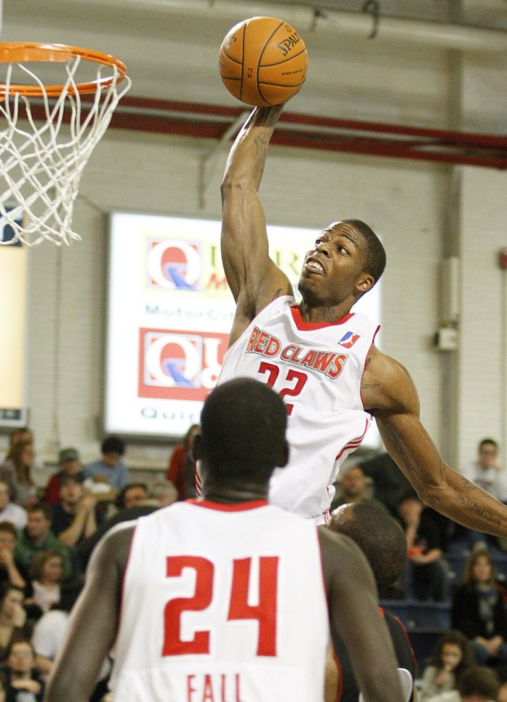 DeShawn Sims of the Red Claws goes up for a dunk Friday night during a 90-80 victory over Springfield at the Portland Expo. Sims scored a game-high 25 points as the Red Claws ended a four-game losing streak.
