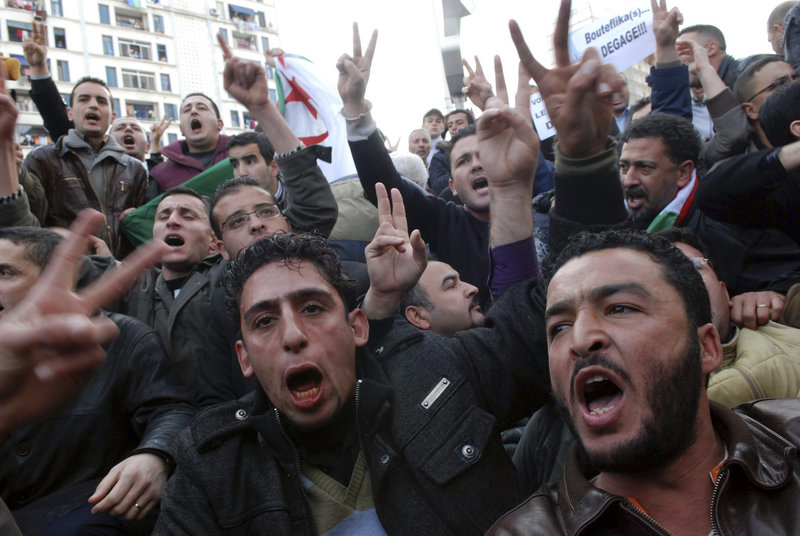 Algerian protesters chant slogans during a demonstration in Algiers, Algeria, on Saturday, despite a ban on protests.