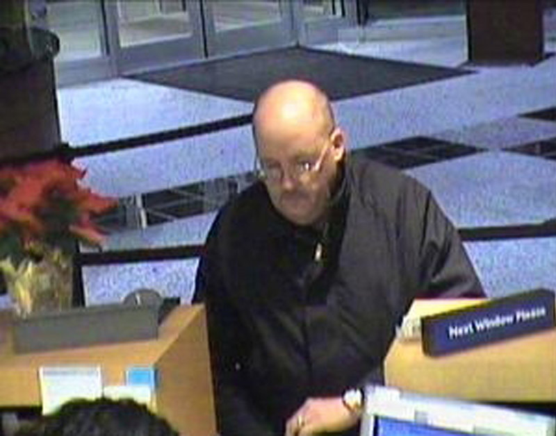 "This image, taken from surveillance video provided by the U.S. Attorney s Office for the Eastern District of Virginia, shows a suspect dubbed the ""Granddad Bandit"" robbing a bank in Virginia in December 2008."