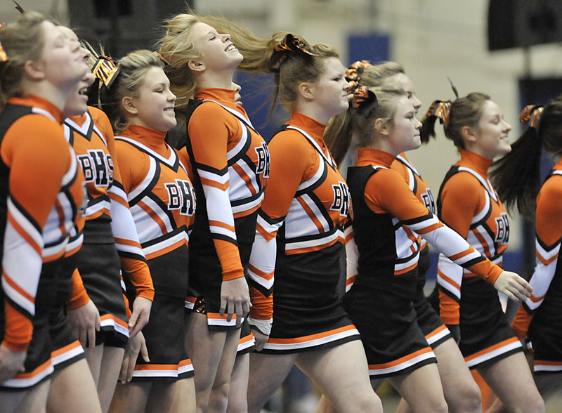 The Biddeford High cheerleaders go through their routine Saturday during the state championships at the Bangor Auditorium. Biddeford, which won the past three state titles, finished third behind Lewiston, which set a state record with 168.5 points, and Marshwood.