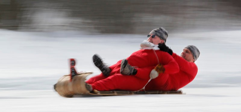 The Redneck Rocket Boys two-man sled team consisting of Mark Kelley of Hollis, in front, and Gary LaPerriere of Sanford races past the finish line on Saturday.