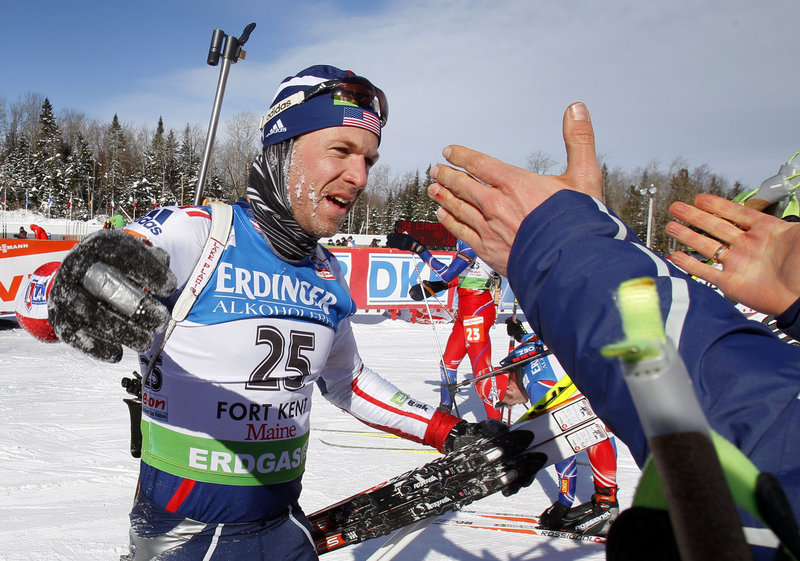 Maine Winter Sports Center alumnus Lowell Bailey accepts congratulations from a cheering crowd Sunday after he outraced Ukranian and German competitors to cap the first top-10 finish of his World Cup career, placing ninth in the final event in Fort Kent.