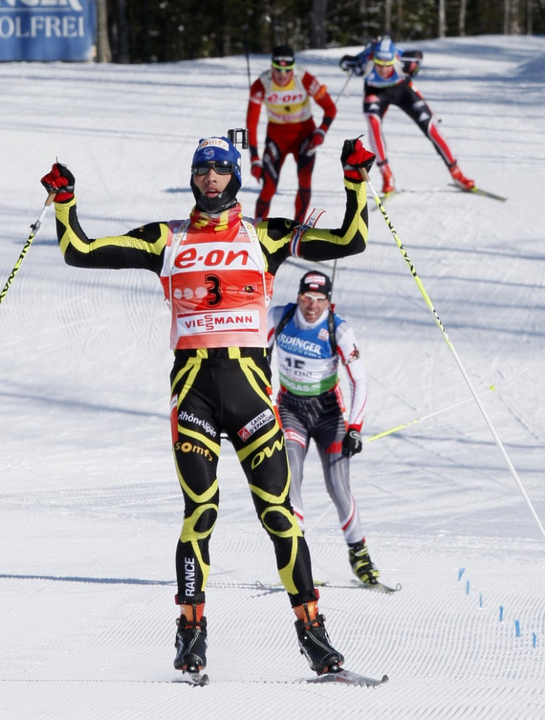 Martin Fourcade of France wins the men's 15K mass start Sunday in Fort Kent. Poland's Tomasz Sikora was second and Norway's Tarjei Boe third.