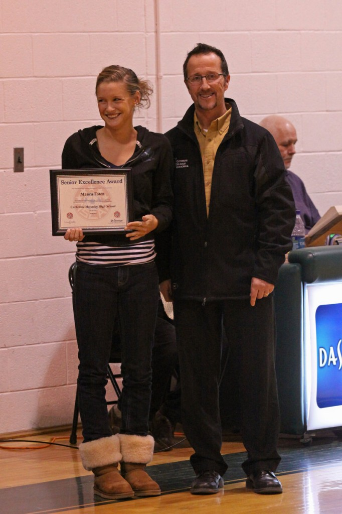 Maura Esten, captain of the girls' soccer team at McAuley High School in Portland, received the National Soccer Coaches Association of America Senior Excellence Award in recognition of significant team contributions, leadership skills and her positive attitude. Esten is pictured with McAuley Coach Vince Aceto.