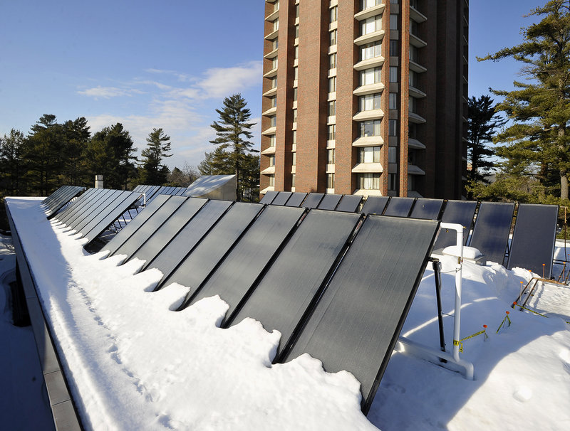 An array of solar units sits on the roof of Bowdoin College's Thorne Dining Hall in 2014.