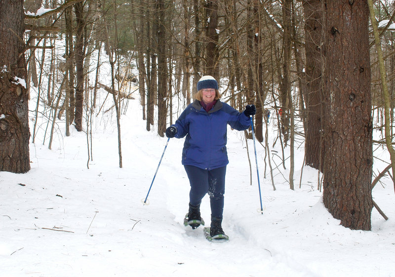 Claire Gamache of Lewiston enjoys a bit of solitude on the Homestead Trail at Androscoggin Riverlands State Park in Turner. Gamache, who retired last year, was snowshoeing for the first time and said she wanted a winter sport to help her get fit.