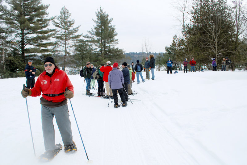 Don Robitaille, 80, starts the second half of a two-hour snowshoe hike in Androscoggin Riverlands State Park last weekend.