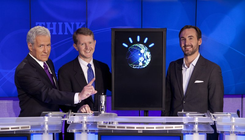 """Jeopardy!"" game show host Alex Trebek, left, poses with returning champion contestants Ken Jennings, center, Brad Rutter, and a supercomputer named Watson at the IBM research center in Yorktown Heights, N.Y."