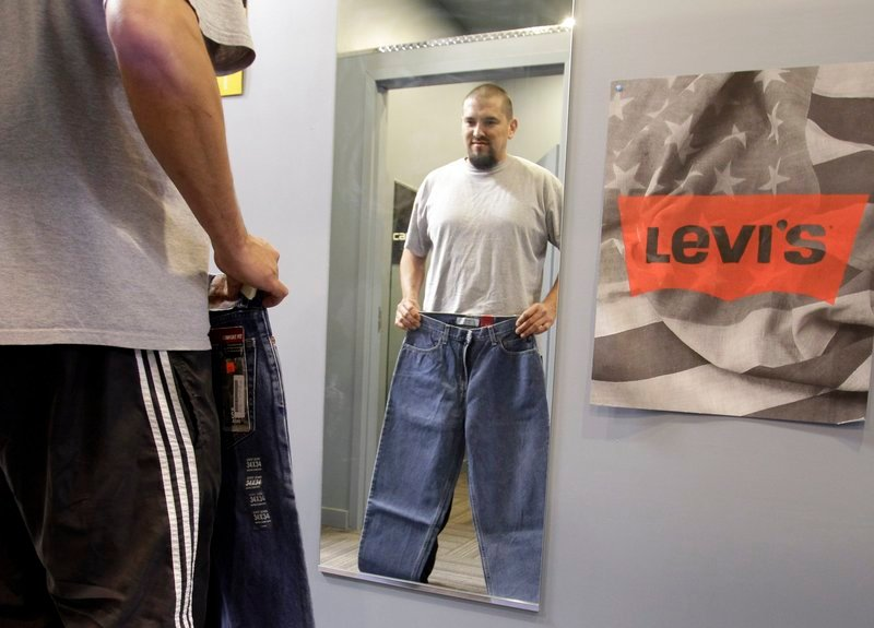Brian Begay shops for a pair of Levi jeans at a store in Hayward, Calif. Apparel prices are expected to climb 10 percent in the coming months, analysts say, paced by the soaring cost of raw materials. Cotton has more than doubled in price in the past year.