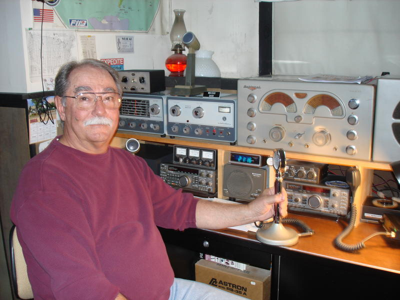 """Amateur radio operator Dave LaPierre of Biddeford sits in his """"shack"""" – a ham term for radio setup. LaPierre also is a collector and restorer of vintage ham radio equipment."""