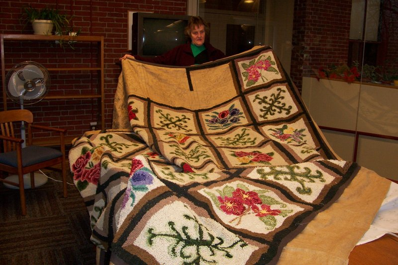 Evelyn Cookson started this rug in 1956, put it away after she married, brought it out and finished it last year. She will tell the tale, and give some instruction, on Feb. 23.