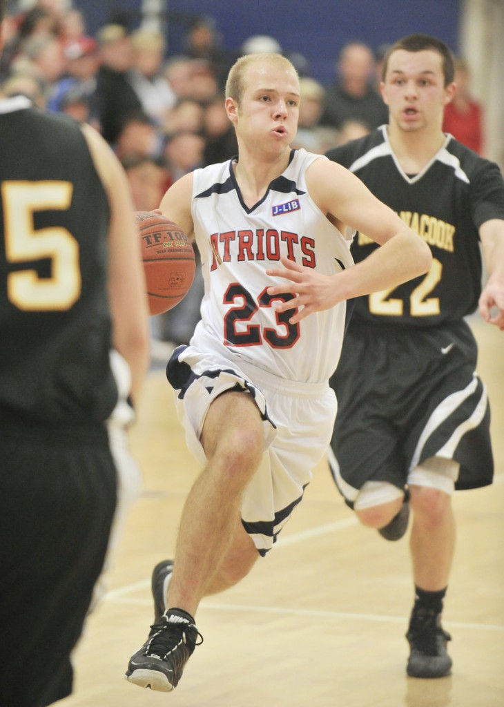 Nick Bennett, whose outside shooting sparked Gray-New Gloucester in the second quarter, also found his way to the basket Tuesday night, driving past Cris Banda of Maranacook during a 61-36 victory in a tourney prelim.