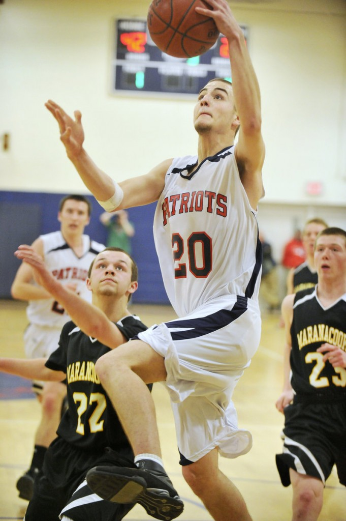 Adam Jensen, who finished with 28 points for Gray-New Gloucester, finds room down the lane. The Patriots will meet Greely at the Expo.