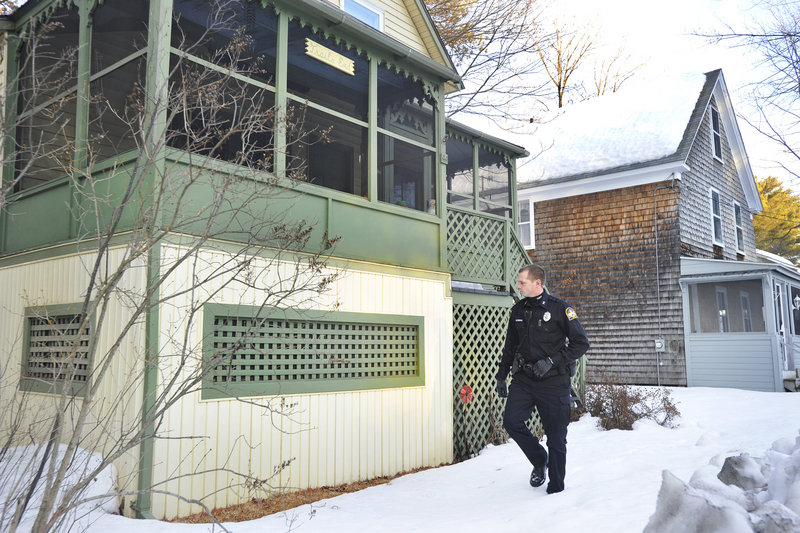 Old Orchard Beach police Officer Joshua Robbins checks for signs of copper-pipe theft in Ocean Park. Police are going cottage to cottage and hope to catch a theft in progress.