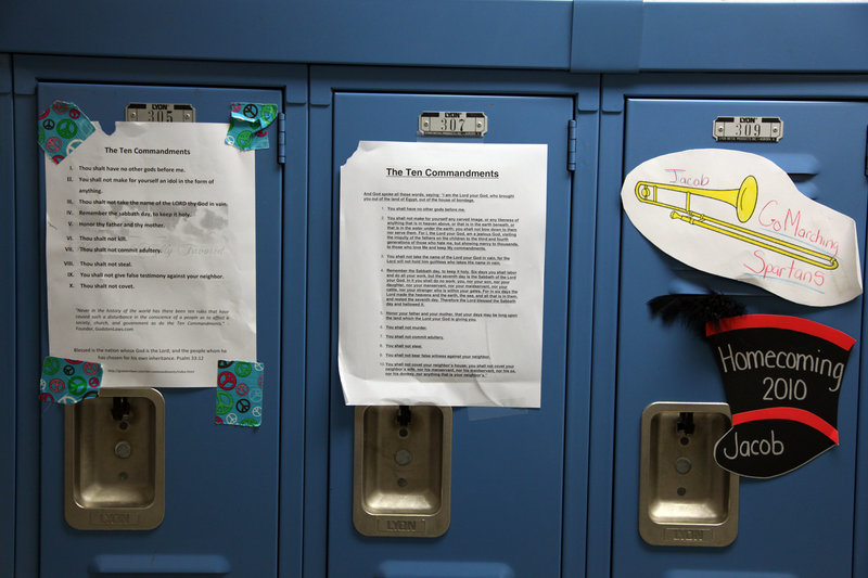 Students at Giles High School in Pearisburg, Va., posted the Ten Commandments on lockers after the superintendent ordered framed displays to be removed from school walls. The school board voted to put the wall displays back up.