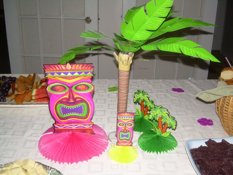 Tiki table decorations don't have to be expensive, and add color and the illusion of getting away from the winter. Besides, who's going to argue with that mask?