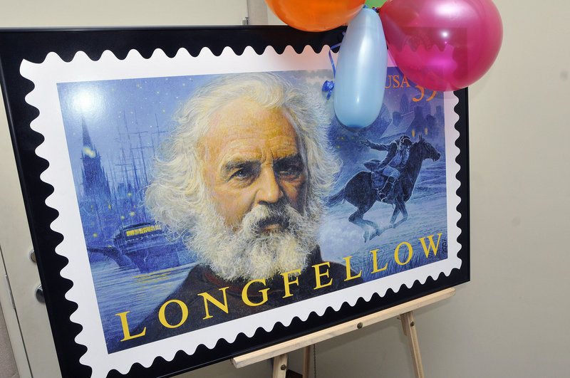 The Henry Wadsworth Longfellow stamp is displayed Saturday at a birthday party for the poet at the Maine Historical Society in Portland. Longfellow was born in Portland in 1807.