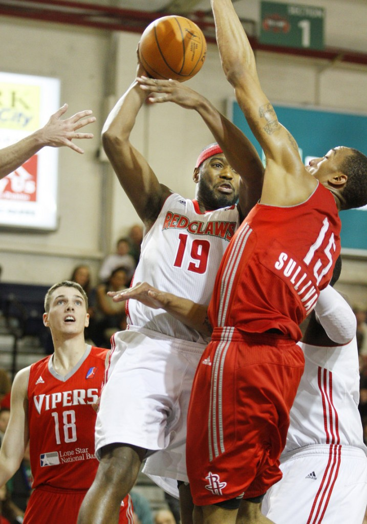 Maine's Mario West, left, looks for an outlet pass as Rio Grande Valley's Patrick Sullivan defends. West had 12 points for the Claws. Sullivan had 21 for the Vipers.