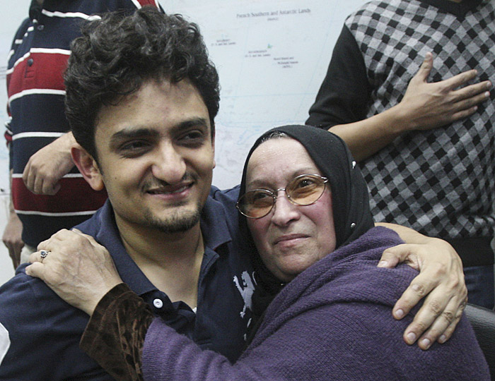 Egyptian Wael Ghonim, a Google Inc. marketing manager, who has become a hero of the demonstrators since he went missing on Jan. 27, two days after the protests began, hugs the mother of Khaled Said, a young 28-year-old businessman who died in June 2010 at the hands of undercover police.