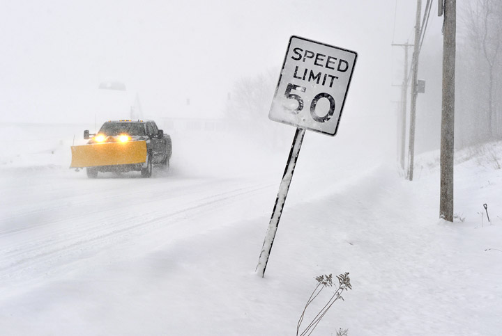 Near white-out conditions and heavy snowfall make for dicey driving conditions this morning on Route 114 in Gorham.