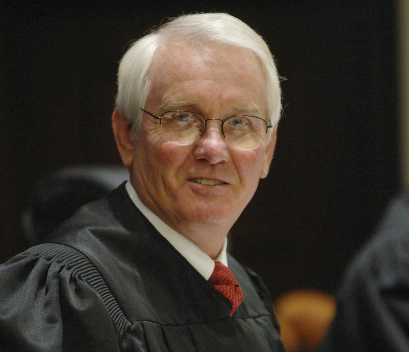 U.S. District Judge Roger Vinson of Florida declared the Obama administration's health care overhaul unconstitutional, saying that people can't be required to buy health insurance.