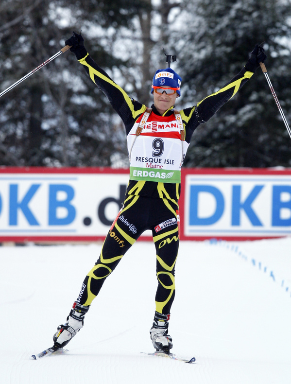 Alexis Boeuf of France celebrates his victory in the men's 12.5K pursuit at the World Cup biathlon event Sunday. Boeuf finished in 36:02.4 for his first World Cup win.