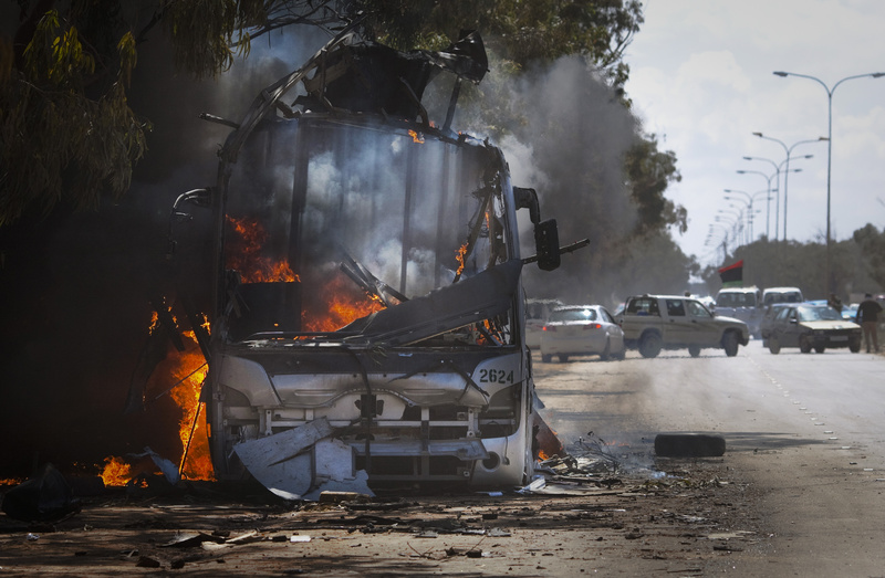 A bus burns on a road leading to the outskirts of Benghazi, eastern Libya, today.