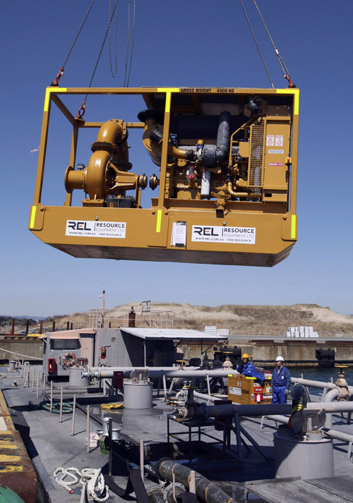 A water pump is lifted by crane onto a U.S. military boat today to ship to the Fukushima Dai-ichi nuclear power plant. Workers at the nuclear power plant resumed the urgent task of pumping out the hundreds of tons of radioactive water inside several buildings at the six-unit plant. The water must be removed and safely stored before work can continue to power up the plant's cooling system, nuclear safety officials said. 9.0 Magnitude Earthquake; Destruction; Devastation; Disaster; Ea