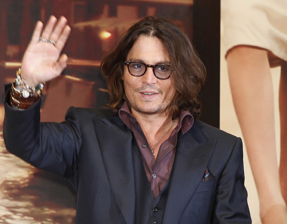 Johnny Depp waves to fans recently in Tokyo.
