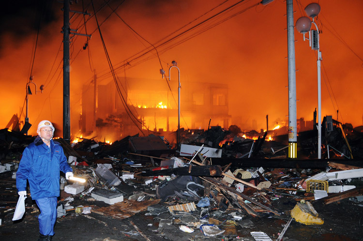 A building burns in Iwaki city, Fukushima prefecture, Japan, after the quake hit today.