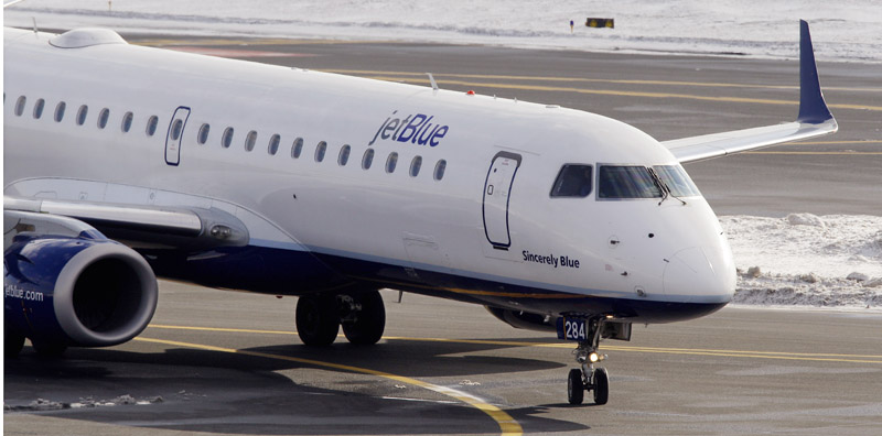 A Jet Blue jet taxis at Boston's Logan International Airport.