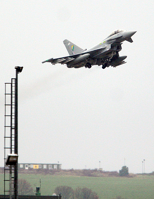 A British Typhoon jet fighter takes off from Gioia del Colle air base near Bari, southern Italy, today. The European Union's top foreign policy official brushed aside concerns today that the coalition supporting military action against Libyan leader Moammar Gadhafi is already starting to fracture, saying the head of the Arab League was misquoted as criticizing the operation.