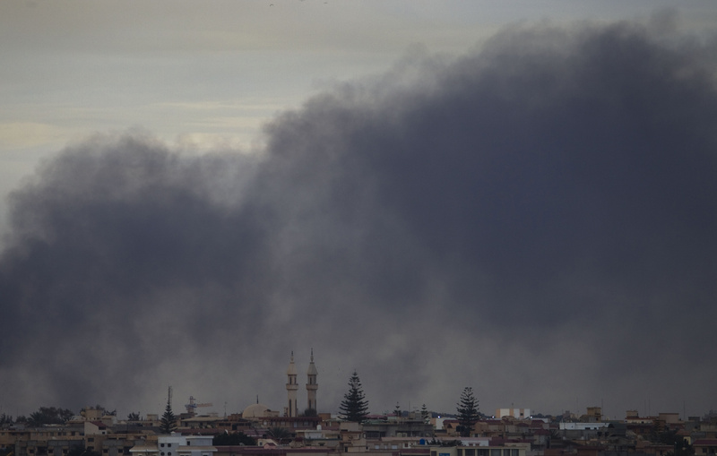 Smoke obscures the sky on the outskirts of Benghazi, Libya, on Saturday.