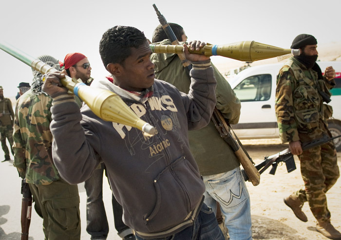 A Libyan rebels carries rockets on a checkpoint on the frontline near Zwitina, the outskirts of the city of Ajdabiya, south of Benghazi, eastern Libya, today.