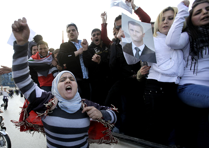 Protesters sympathetic to Syrian President Bashar Assad shout pro-Assad slogans during a demonstration in Damascus today.