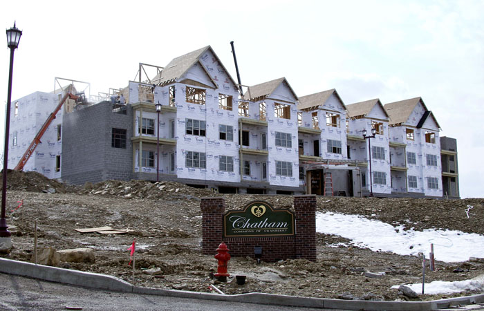 Construction continues recently on a row of condominiums in Cranberry, Pa. Sales of new homes have plunged to a record low, a dismal sign for an already-weak housing market.