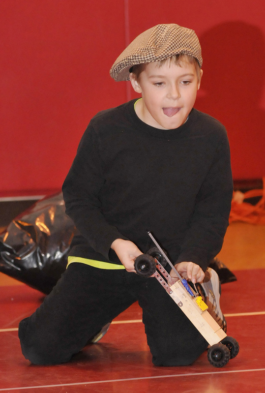 Andrew Sharp, 9, of Village Elementary School in Gorham concentrates as he is about to release his team's vehicle during Extreme Mouse Mobiles.