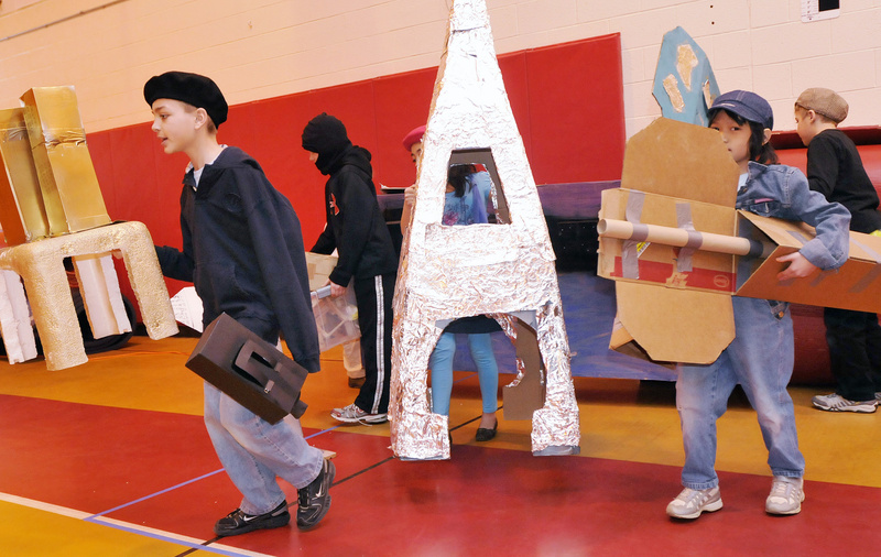 Students from Village Elementary School in Gorham – including Dawson Smith, 9, left, and Kiera Emerson, 8, right – bring out their props during Extreme Mouse Mobiles.