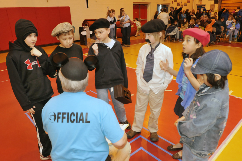 Students from Village Elementary School in Gorham listen to judge Mike Harris of Biddeford before competing in Extreme Mouse Mobiles. From left are Simon Roussel, 10, Andrew Sharp, 9, Dawson Smith, 9, Trevor Gava, 9, Jade Wu, 8, and Kiera Emerson, 8.