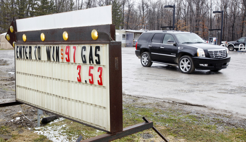 A motorist leaves a service station in New York where gasoline was selling for $3.53 per gallon today.