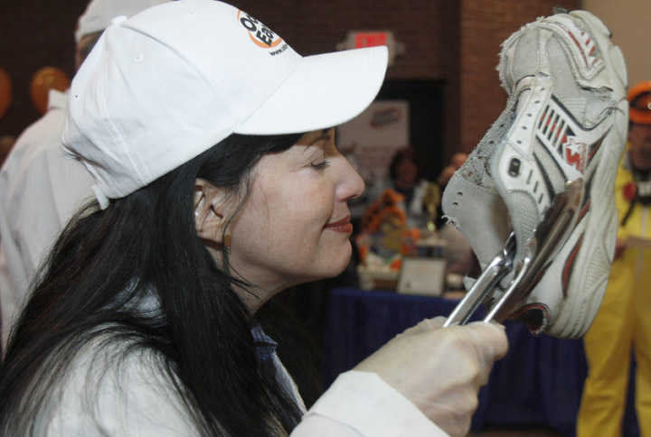 Judge Rachel Herz smells a rotten sneaker in the annual Odor-Eaters Rotten Sneaker Contest today in Montpelier, Vt.