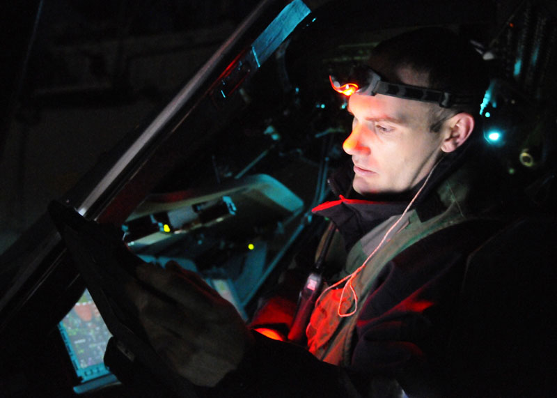 In this March 19, 2011 photo provided by the U.S. Navy, Aviation Electrician's Mate 2nd Class Joseph Fremen, assigned to Helicopter Sea Combat Squadron 22, calibrates the forward looking infrared system of a Sea Hawk helicopter on the flight deck of amphibious assault ship USS Kearsarge in the Mediterranean Sea. After a barrage of attacks by sea-launched Tomahawk cruise missiles on Libya Saturday, an array of U.S. warplanes _ including several Air force B-2 stealth bombers _ followed in the pre-dawn hours Sunday with a coordinated assault using precision-guided bombs, according to a U.S. military official. amphibious assault ship USS Kearsarge (LHD 3) Libya Odyssey Dawn