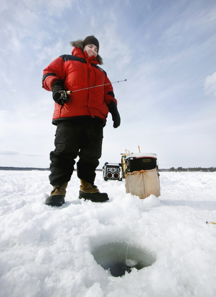 "Colby Hakkila of Falmouth fishes on Jordan Bay during the Sebago Lake Rotary Club Derby on Feb. 26. Referring to stories of a togue in Sebago that could top the state record of 31.8 pounds and win the $100,000 derby prize, Hakkila said, ""The hope is still alive."" He also said he would have to drill another hole to get it out."