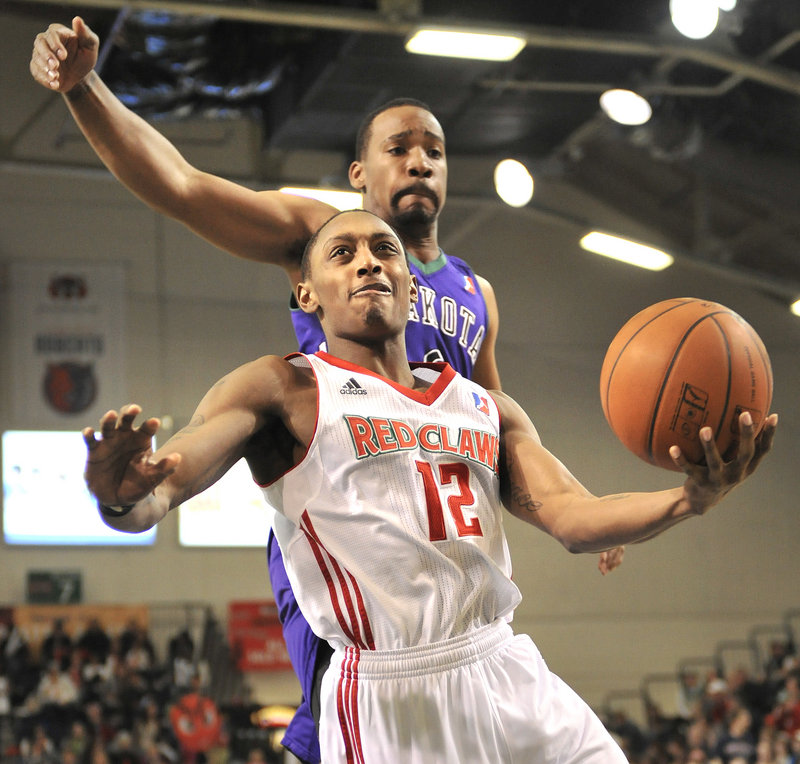 Kenny Hayes of the Red Claws beats Dakota's Javaris Crittenton and drives in for a layup Thursday night at the Portland Expo. The Wizards rallied late for a 104-103 win.