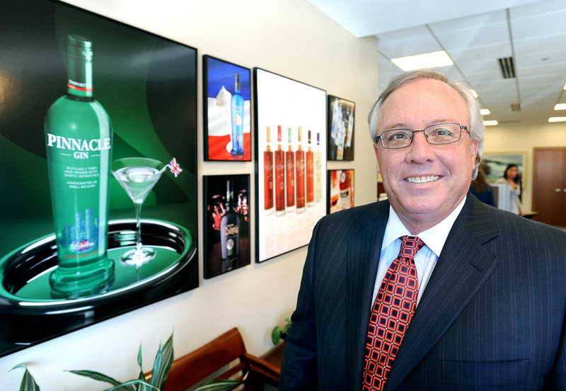 Paul Coulombe, CEO of White Rock Distilleries, shown at his office in Portland, began in the business as a salesman. The company has evolved into bottling, branding and distribution.
