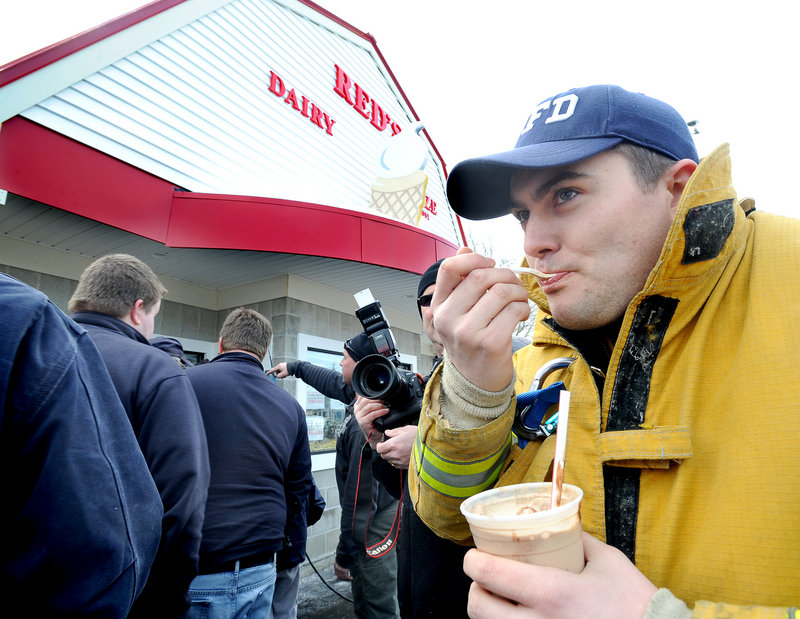 Chris Swenson, a South Portland firefighter, savors a triple-chocolate Boston shake Friday at Red's Dairy Freeze. Swenson helped fight the fire that closed the soft-serve landmark last May.