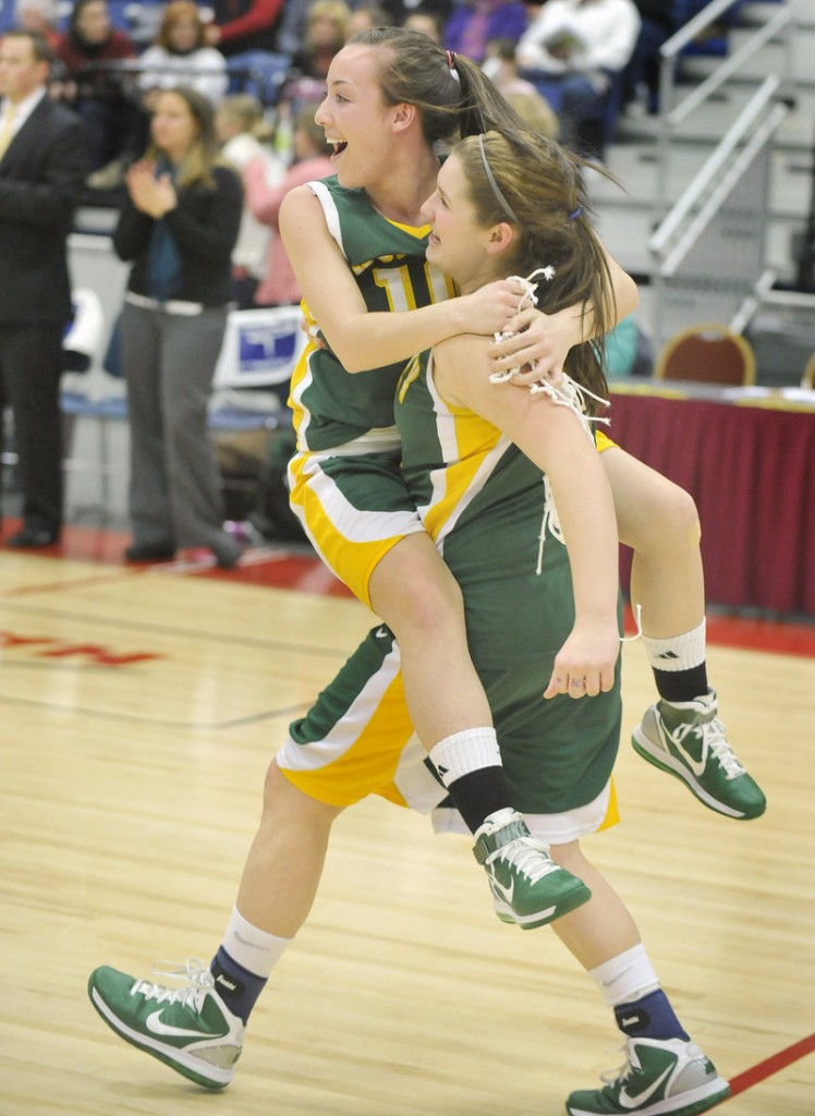 The final buzzer sounds and the excitement begins as Olivia Porch gives Kayla Daigle a lift to join their teammates for the celebration.