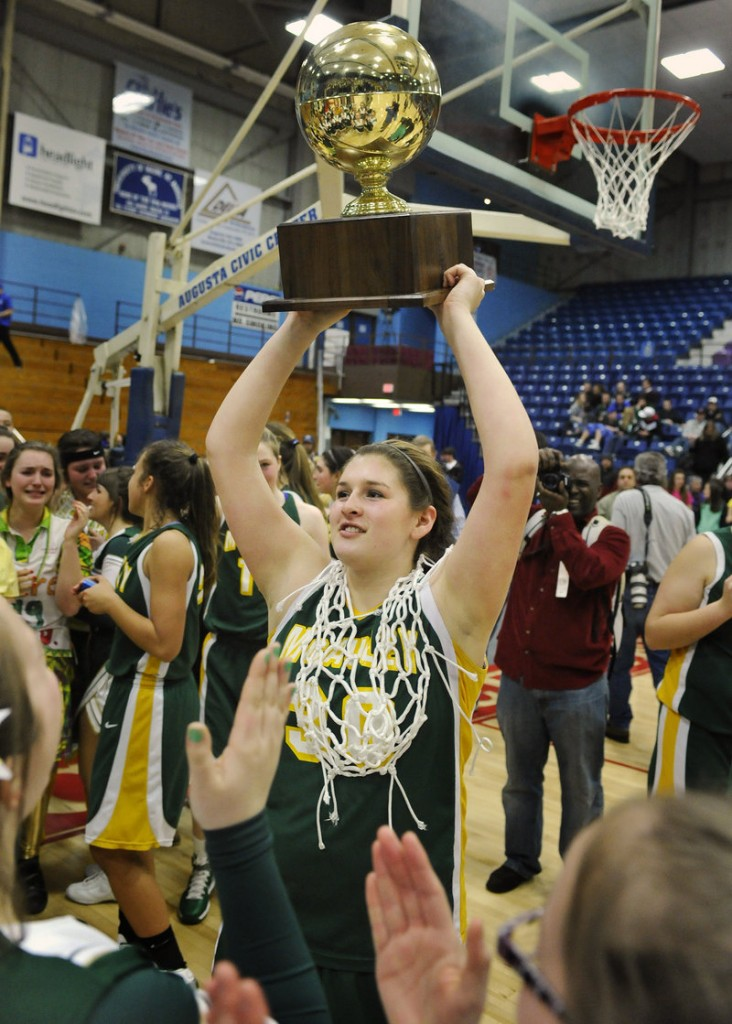 It's the ultimate reward in Maine high school sports, the cherished Gold Ball, and Olivia Porch proudly displays it to the crowd after McAuley's victory.