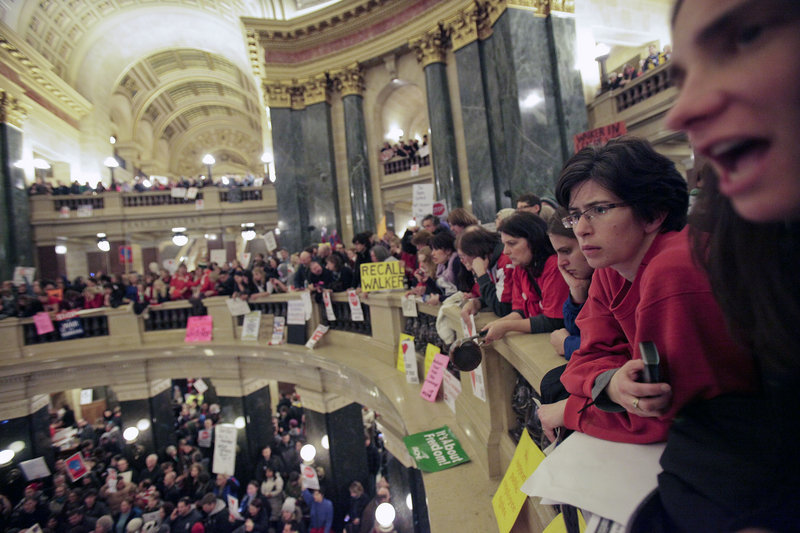 Protesters line the Capitol balcony in Madison, Wis., in this March 9 file photo.